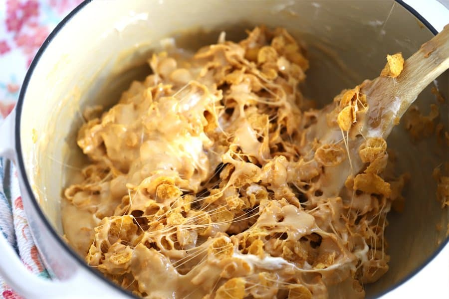 Cornflake cookie ingredients being mixed in a pot.
