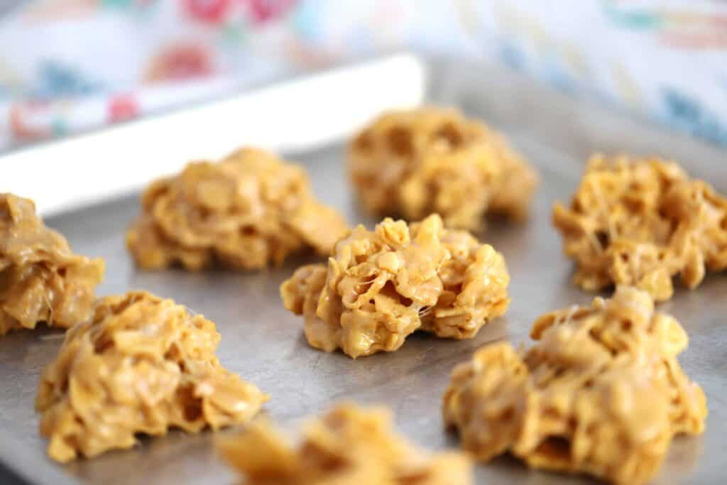 Peanut Butter Cornflake Cookies on a sheet tray.