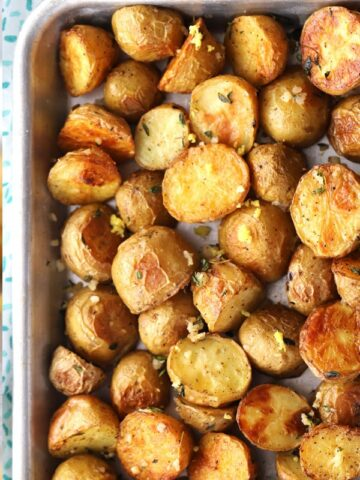 Garlic and Thyme Roasted Potatoes, crispy and chewy and bursting with flavor!