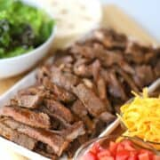 Carne Asada and Taco ingredients on a platter