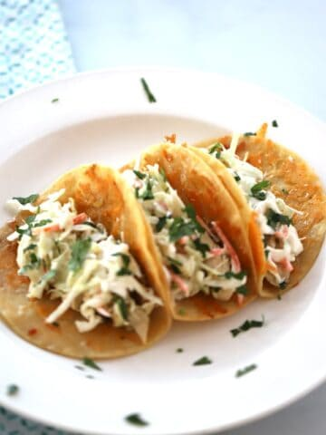 Slow Cooker Cilantro Lime Chicken tacos are delicious on taco tuesday and the other 6 days of the week we wish were taco Tuesday! So delicious!