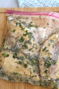 Cilantro Lime Chicken marinating with garlic, fresh cilantro, fresh lime juice, and spices. So much flavor packed into this incredible meal!