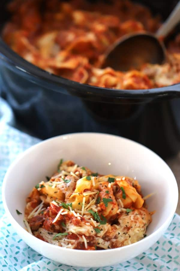 This slow cooker cheese tortellini pasta bake has a spicy ground sausage meat sauce with Mozzarella cheese and cheese tortellini! Yummo!!