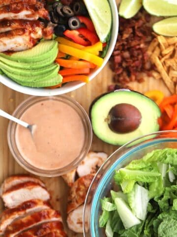 Salad ingredients are grilled chicken, loads of veggies and plenty of tangy BBQ ranch dressing