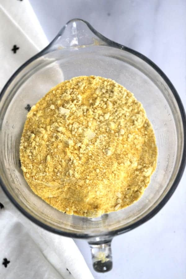 How to make the best cornbread, use fresh ground corn. Cornmeal in a measuring bowl.
