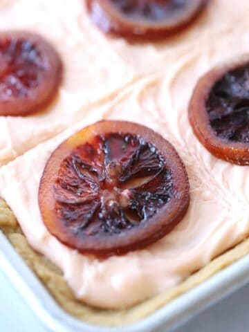 Sugar cookie bars with blood orange cream cheese frosting and candied blood oranges