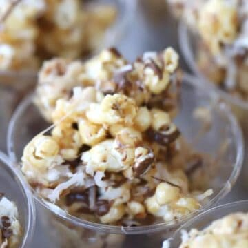 Coconut caramel popcorn balls with a chocolate drizzle