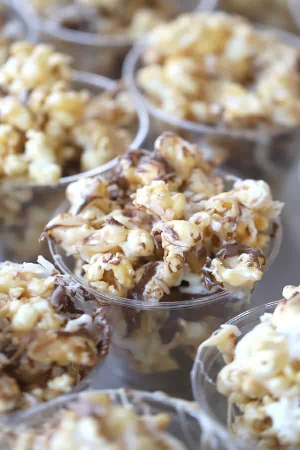Coconut caramel popcorn in small party cups.