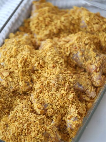 cornflake fried chicken, baked cornflake chicken in a baking dish
