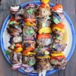beef shish kabobs cooked and on a plate