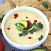 white queso in a white bowl