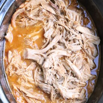 sweet pork cooked and shredded in a slow cooker
