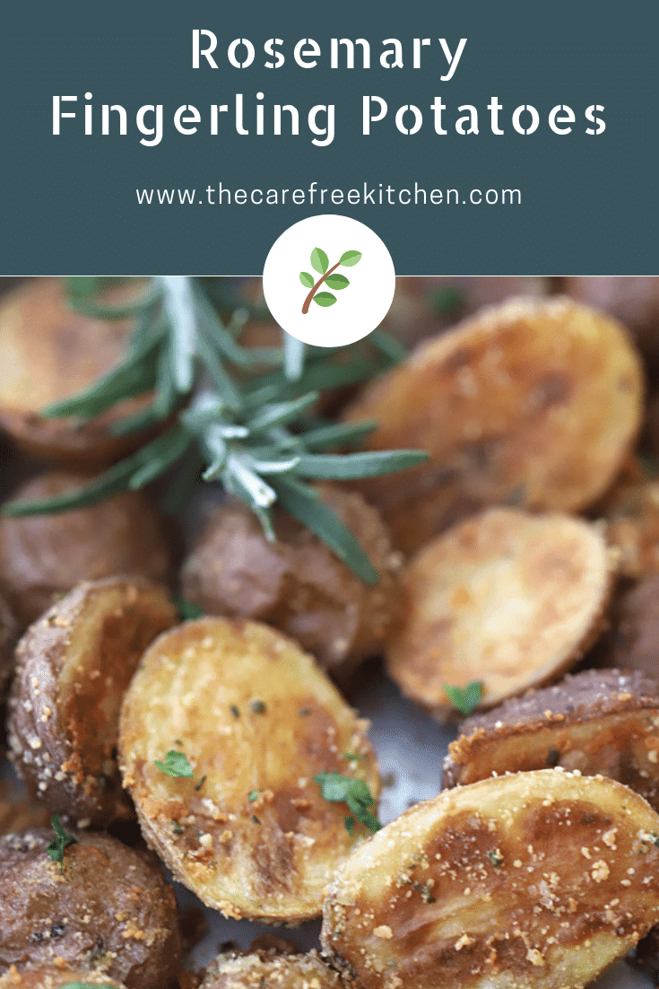 roasted fingerling potatoes with a sprig of rosemary