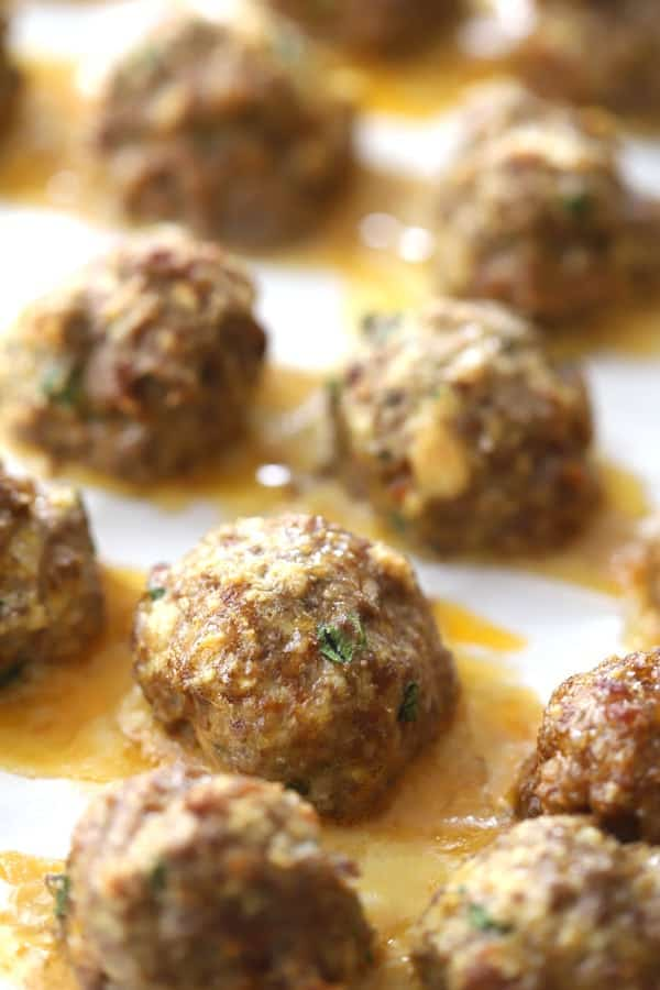 italian meatballs on a baking sheet