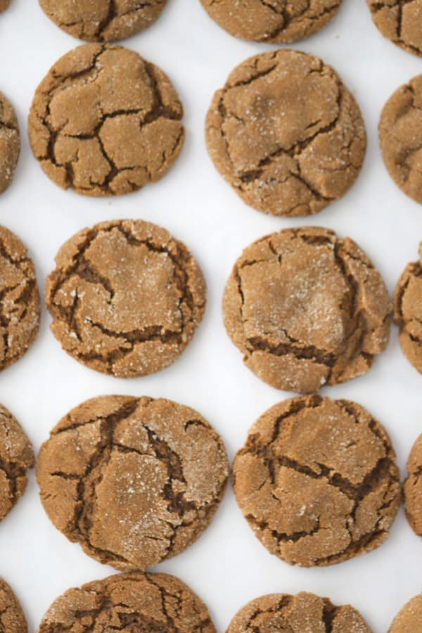 Gingersnap cookies lined up on a baking sheet.