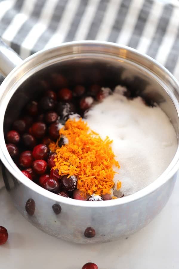 orange cranberry sauce ingredients in a saucepan