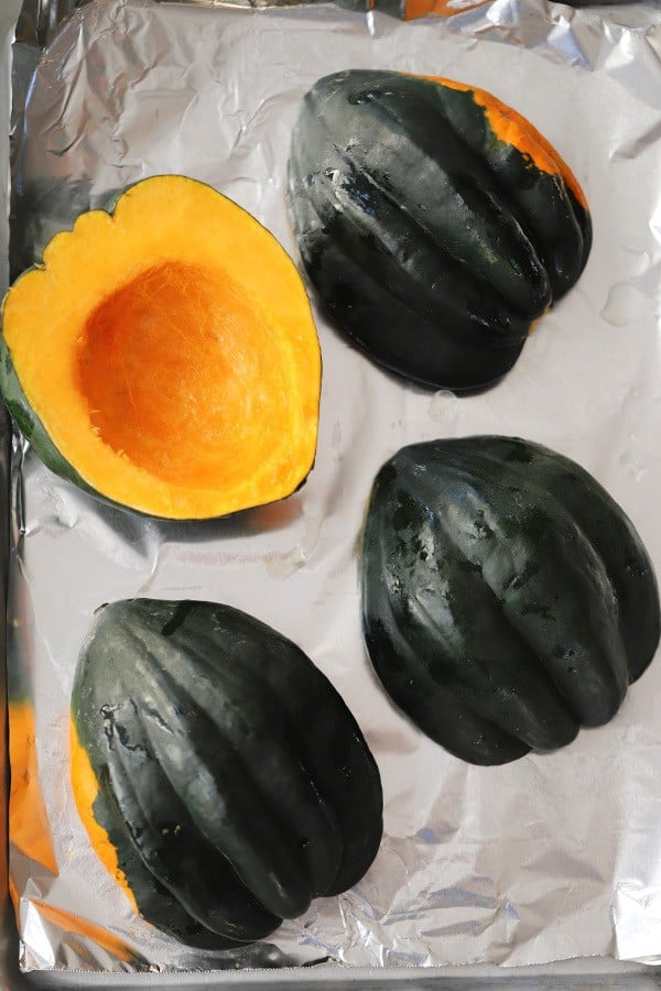 raw squash, on a baking sheet with tin foil