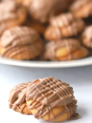 These nilla wafer caramel candies are such an easy Christmas Candy recipe. They have a little dollop of homemade caramel and a drizzle of sweet milk chocolate.