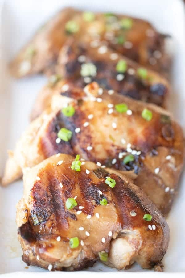 grilled teriyaki chicken on a platter