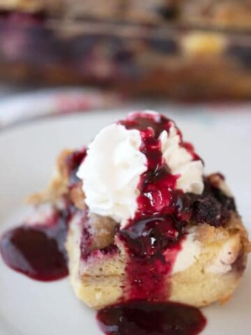This is an easy mixed berry overnight French toast bake. It's made with simple ingredients, frozen mixed berries, milk, cream cheese, and eggs. It's a deliciousovernight French toast casserole with streusel topping.