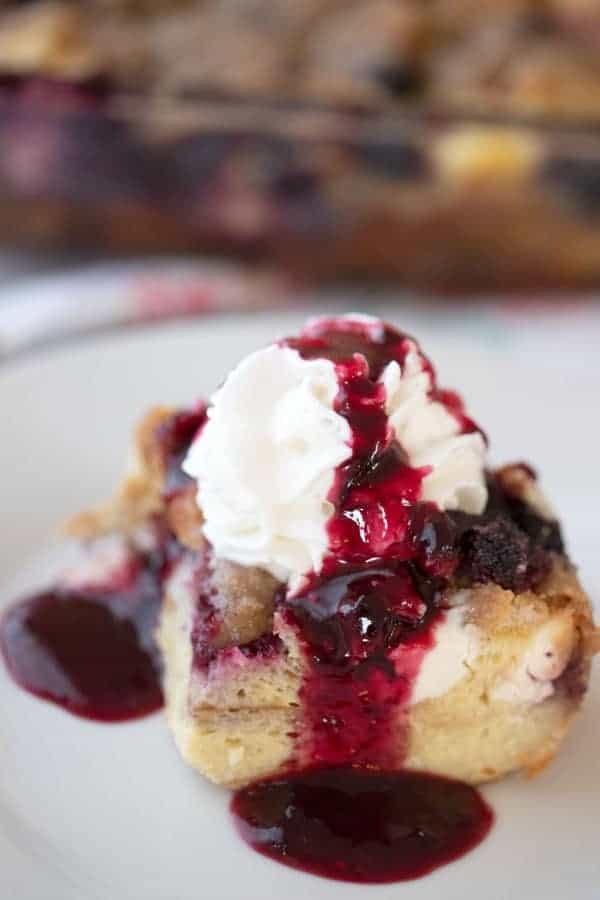 This is an easy mixed berry overnight French toast bake.  It's made with simple ingredients, frozen mixed berries, milk, cream cheese, and eggs.  It's a delicious overnight French toast casserole with streusel topping.