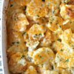 homemade scalloped potatoes in a white baking dish