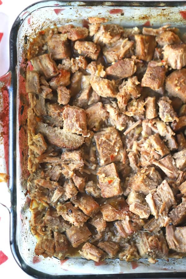 shredded beef carnita meat in a baking dish