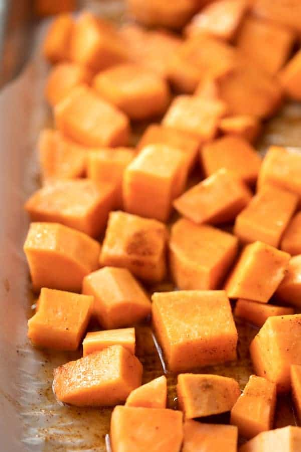 sweet potato chunks on a baking sheet