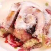 triple berry sweet roll with lemon icing
