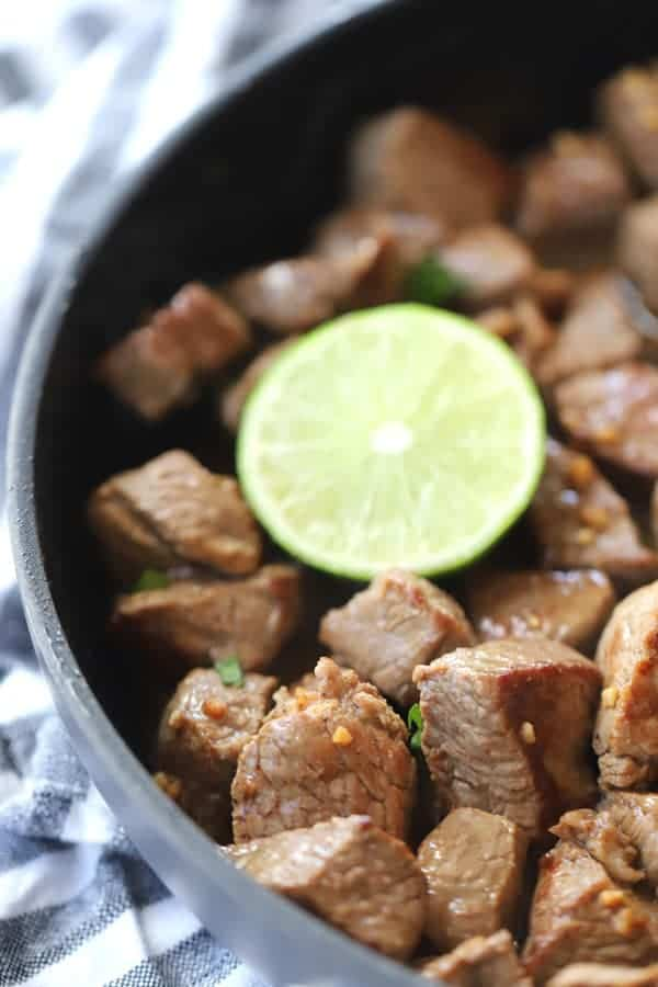 chili lime steak bites in a dark pan