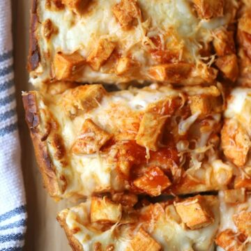 buffalo chicken french bread pizza on a cutting board