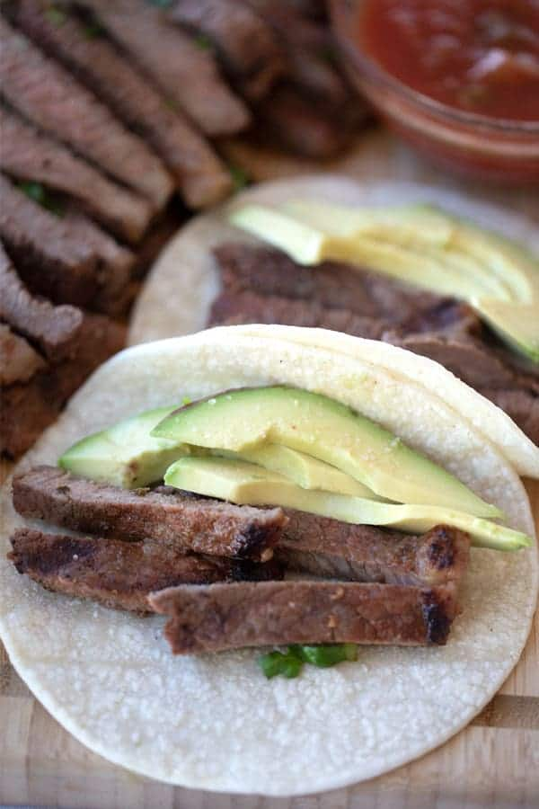 carne asada tacos in corn tortilla shell with avocado