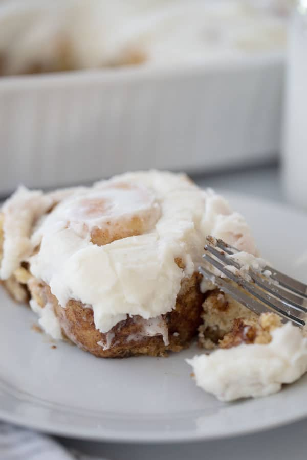cinnamon roll on a white plate