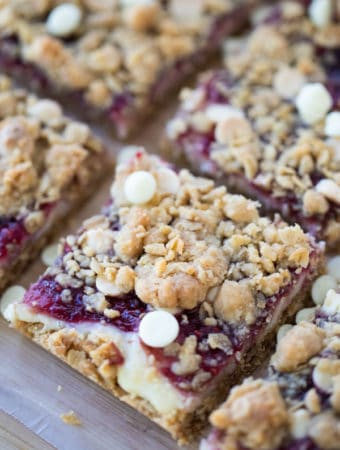 Cookie Bars with White Chocolate and Raspberry cut into squares