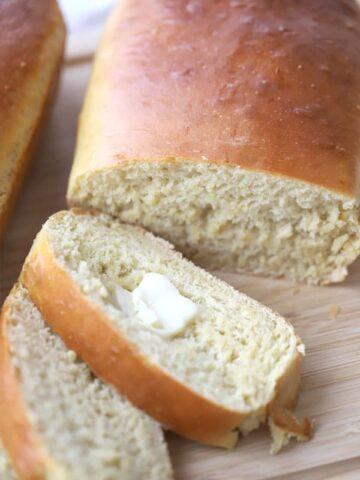 Einkorn white bread sliced on a wood cutting boars
