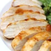 Grilled apricot chicken on a white plate