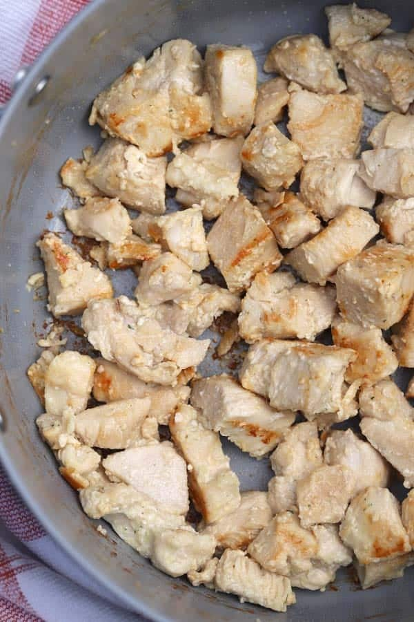 chicken breast chunks in a frying pan