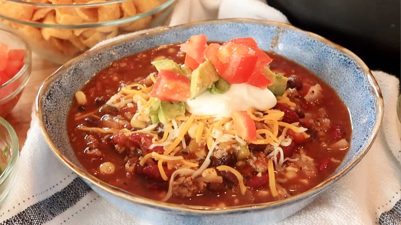 taco soup loaded with sour cream, cheese, and corn chips