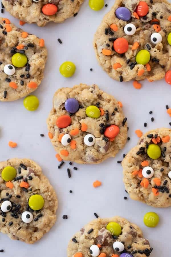 Monster cookies decorated with M&Ms, sprinkles and candy eyeballs.