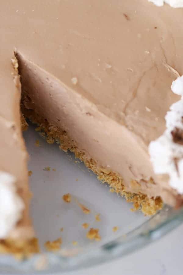 no bake cheesecake, chocolate with a slice missing