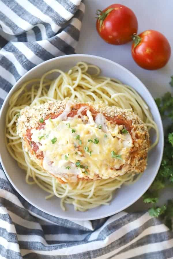 chicken parmesan in a bowl with noodles