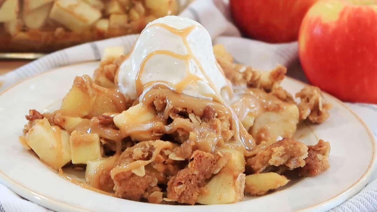 warm apple crisp with vanilla ice cream on top
