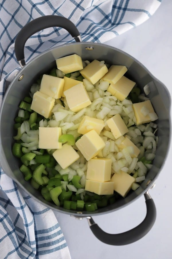 Onions, celery and butter in a pot getting ready to make Grandma's Thanksgiving Stuffing.