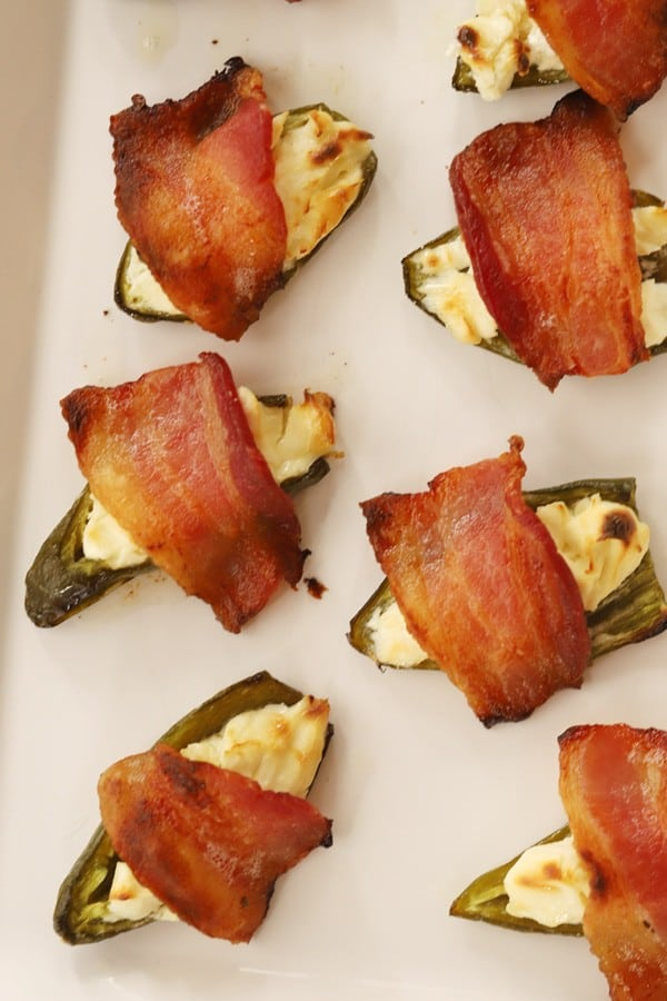 Cream cheese stuffed jalapenos topped with bacon.
