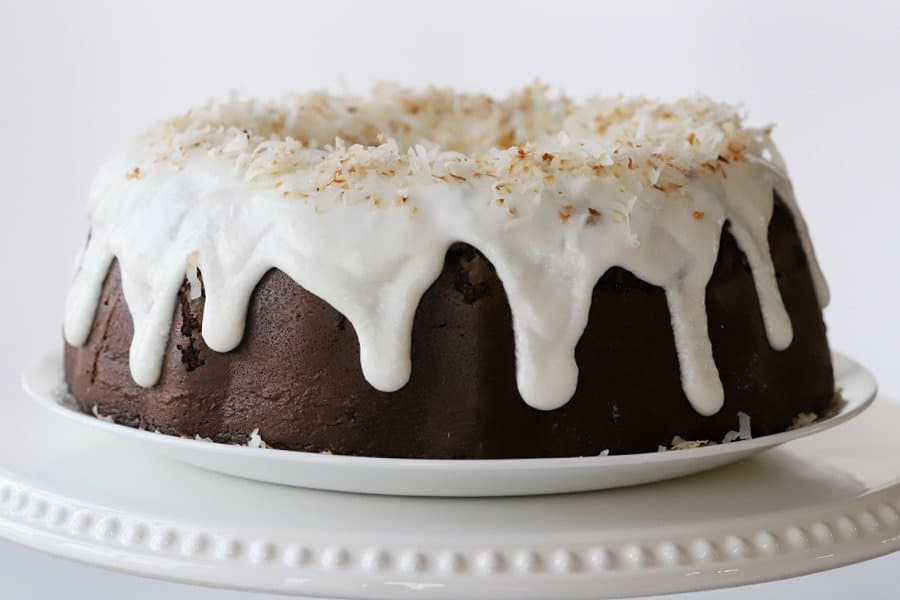 chocolate bundt cake with coconut filling on platter