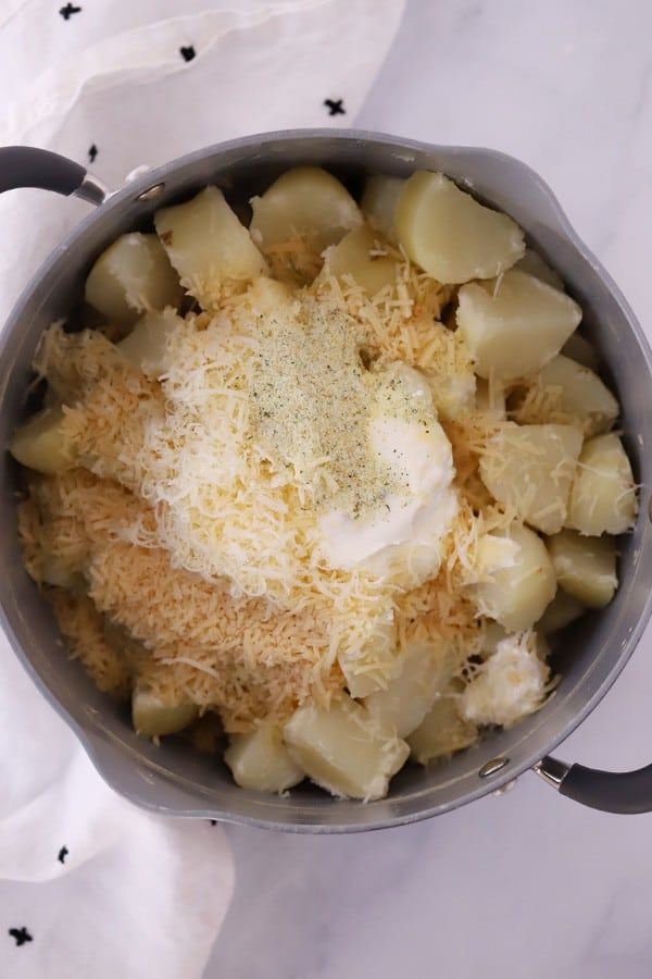 mashed potatoes with ingredients in a pot