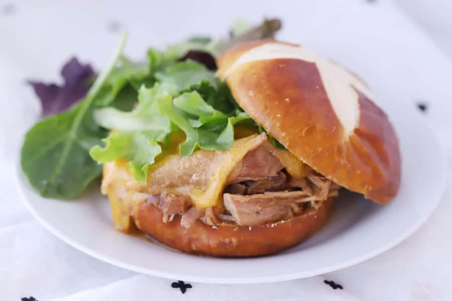 Pork Roast shredded on a pretzel bun