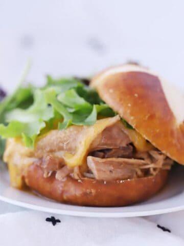 mississippi pork roast on a pretzel bun