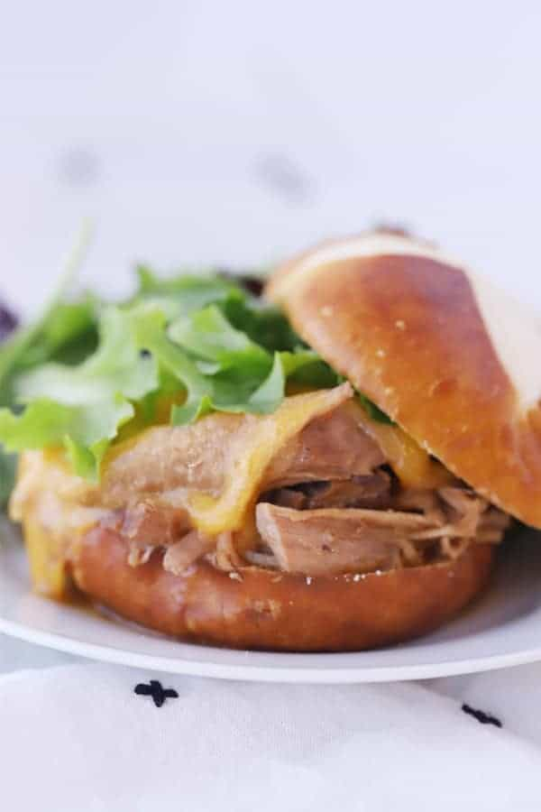 mississippi pork roast on a pretzel bun