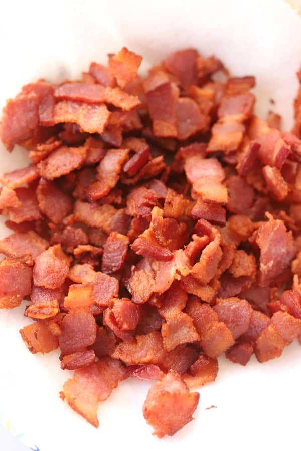 Homemade bacon bits on a paper plate